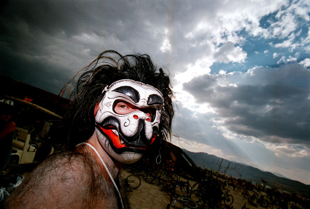 A man wearing an animal mask glances at the camera during the15th annual Burning Man festival September 2, 2000 in the Black Rock Desert near Gerlach, Nevada.