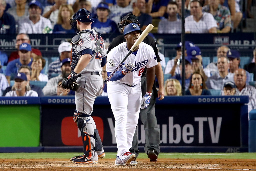 Yasiel Puig of the Los Angeles Dodgers licks his bat during the seventh inning against the Houston Astros.