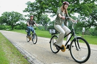 Two people delighted to be participating in a bike sharing program.