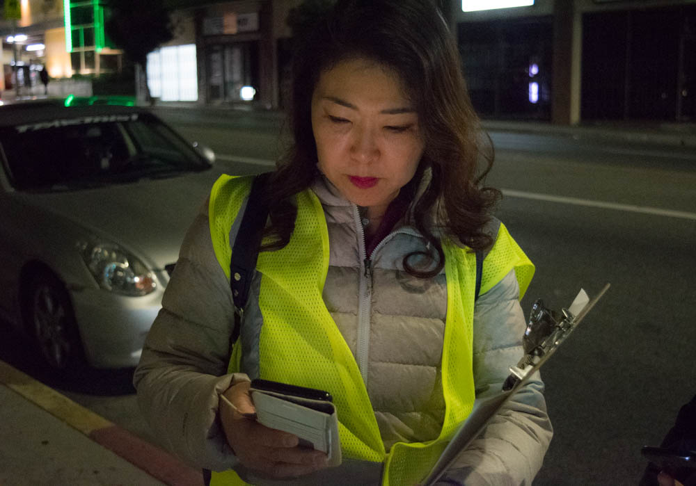 Hyepin Im reviews the tally form for the 2018 Koreatown Homeless Count during her volunteer shift the evening of Jan. 25, 2018. Volunteers traveled in small groups to collect accurate data on the homeless population in different census tracts.
