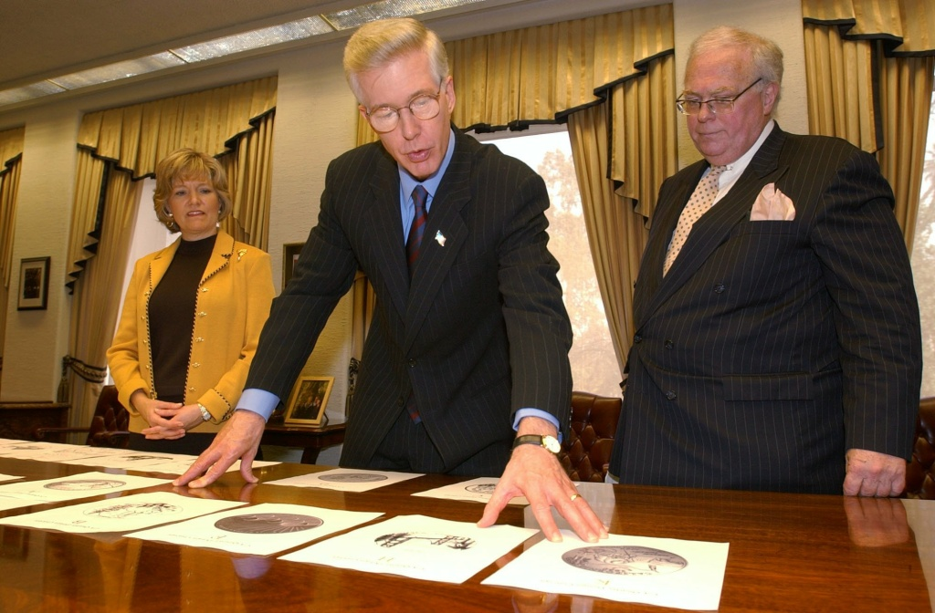 Gov. Gray Davis along with state librarian Kevin Starr, right, and first lady Sharon Davis, left, look over some of the finalists for the design of California's commemorative quarter at the Capitol, Tuesday, March 11, 2003, in Sacramento, Calif. Starr, who was an accomplished scholar and public figure, researched and wrote a series of books considered the definitive account of the California story. He died Saturday at 76.