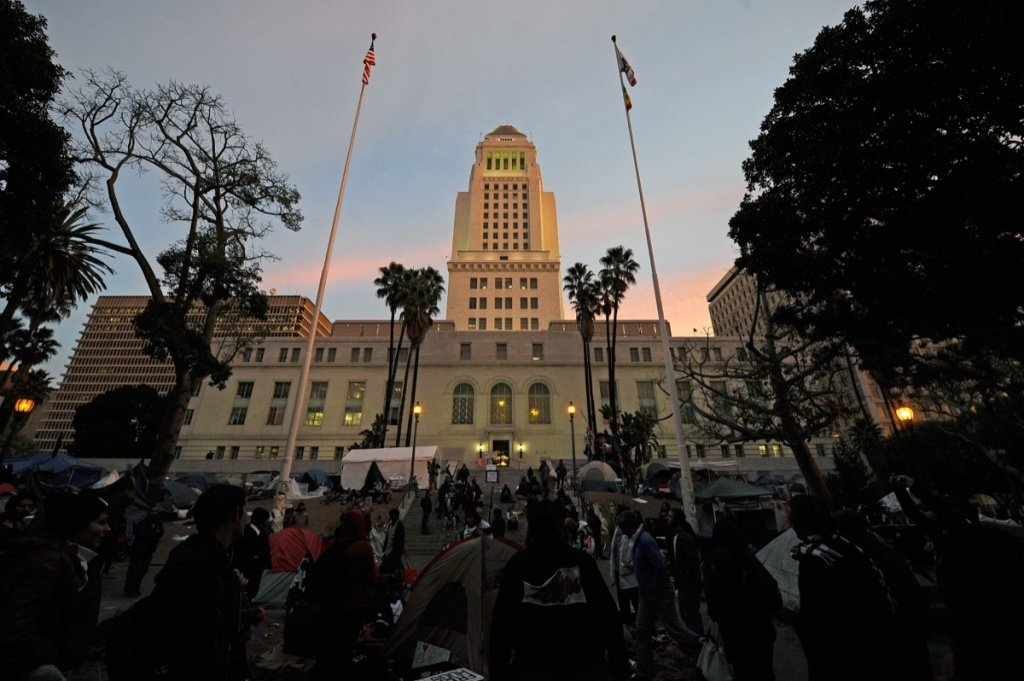 Occupy LA protesters demonstrate on the front lawn of Los Angeles City Hall after the midnight deadline set by city officials to shut down the encampment expired on November 28, 2011 in Los Angeles, California. The Occupy Movement is planning to start a