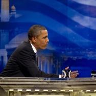 US President Barack Obama (L) tapes an i