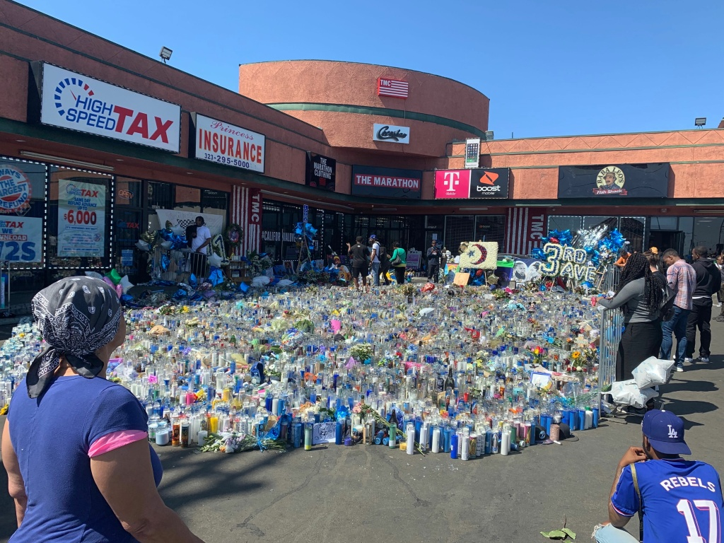 Hundreds stopped by a memorial for Nipsey Hussle outside his clothing store Marathon, where he was shot and killed in late March.