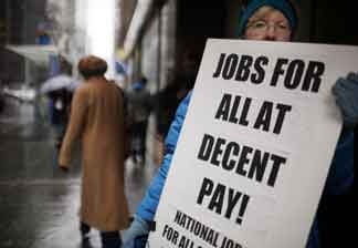 Sheila Collins protests with others outside of U.S. Senator Charles Schumer`s office to demand more jobs on April 1, 2011 in New York City. The U.S. Labor Department announced on Friday that the unemployment rate fell to 8.8 percent last month as the U.S. economy enjoyed a net gain of 216,000 new jobs.