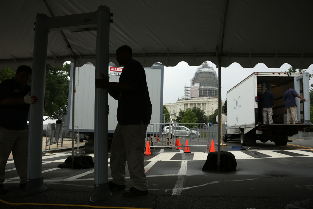 Workers set up a security checkpoint for the Capitol Fourth concert at the west front of the U.S. Capitol July 2, 2015 in Washington, DC. Security has been increased for the upcoming July 4th holiday.
