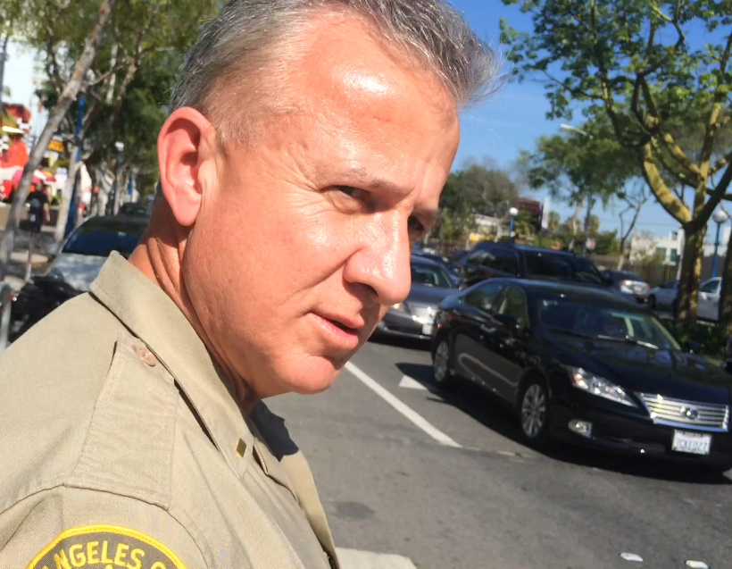Lt David Smith with the LA County Sheriff's Department – West Hollywood Division demonstrates how to properly cross the street.
