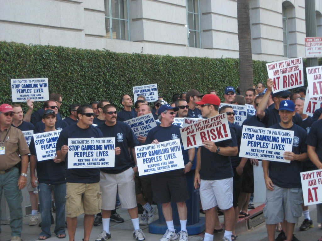 Off-duty Los Angeles firefighters protest budget cuts outside City Hall