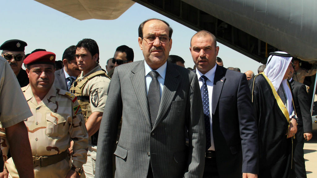 In this file photo, Iraqi Prime Minister Nouri al-Maliki (center) arrives on May 8 at Kirkuk airport in northern Iraq, on his first visit to the multi-ethnic city since taking office.