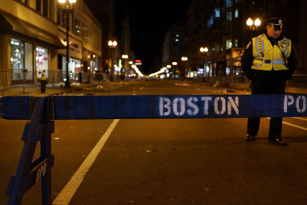 A Boston police officer near the scene of the Boston Marathon bombings last month. An amendment to the Senate immigration bill that would tighten student visa rules, and which was prompted by the April 15 bombings, was approved Tuesday by Senate Judiciary Committee.