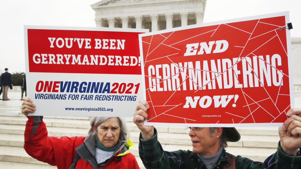 Sara Fitzgerald and Michael Martin, both with the group One Virginia, protest gerrymandering in front of the Supreme Court in March 2018.