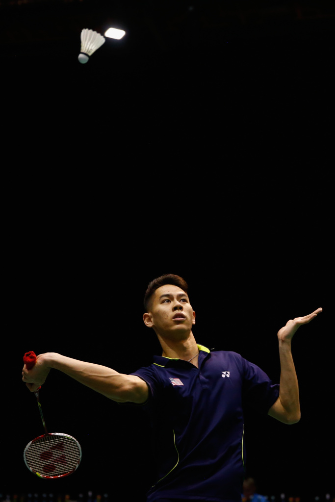 Howard Shu of the USA plays a return to Shesar Hiren Rhustavito of Indonesia during their mens singles match in the 2015 Badminton Open at the North Shore Events Centre on April 29, 2015 in Auckland, New Zealand.