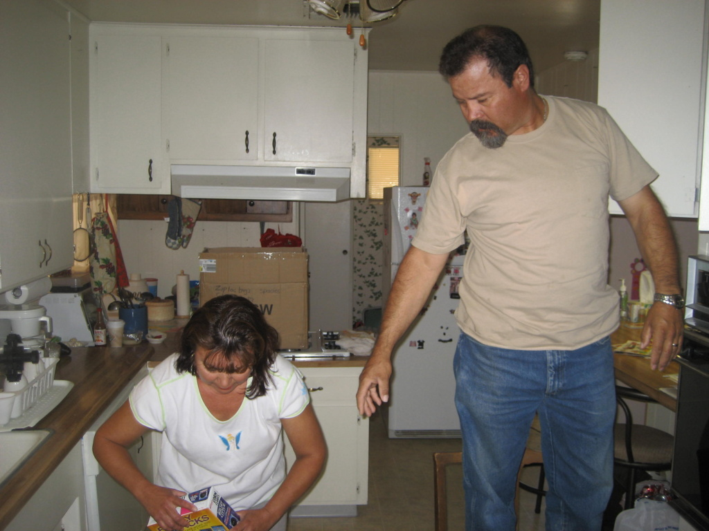 Cesar and Reyna Hernandez pack up the cereal.