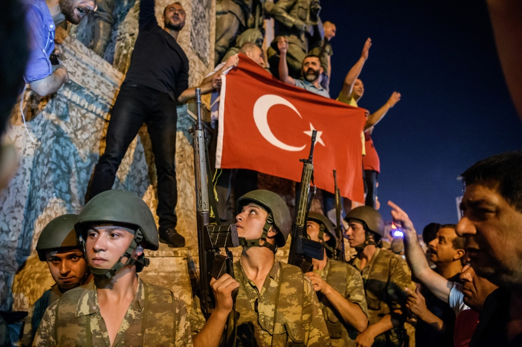 Turkish solders stay with weapons at Taksim square as people protest against the military coup in Istanbul on July 16, 2016.