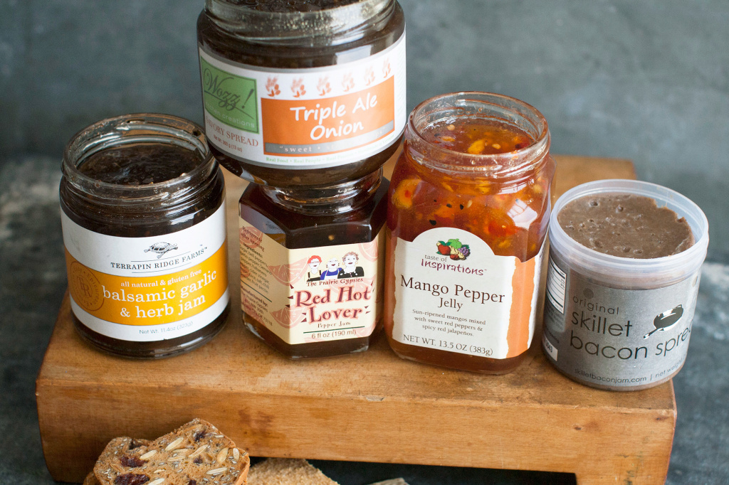 This 2014 photo shows an assortment of savory jams. From left to right, Terrapin Ridge Farms balsamic garlic and herb jam, Wozz Kitchen Creations triple ale onion jam, The Prairie Gypsies red hot lover jam, Taste of Inspirations mango pepper jelly, and Skillet Bacon Spread original bacon spread.