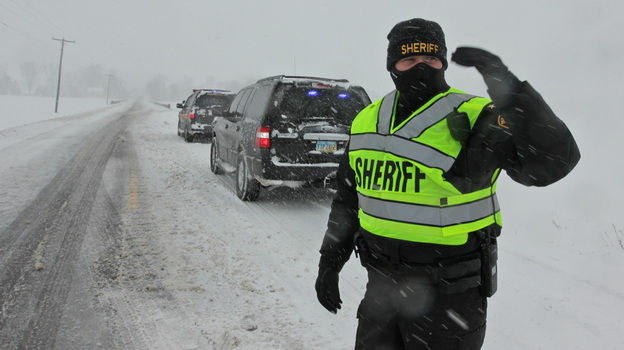 Union County (Ohio) Sheriff Jamie Patton directed traffic around an accident near Marysville on Wednesday, December 26, 2012.