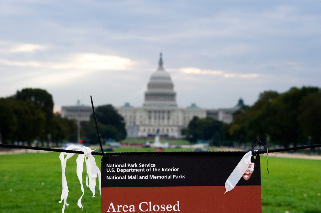 A sign that telling visitors that the area is closed for restoration is posted on the National Mall near the US Capitol in Washington, DC, October 1, 2013. The US federal government shut down for the first time in 17 years on Tuesday, after hours of political brinkmanship failed to end a congressional budget row.