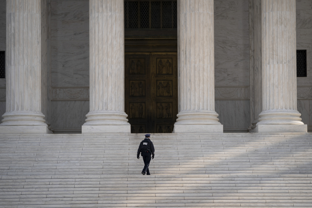 A Supreme Court Police officer walks up the steps at the U.S. Supreme Court in Washington, DC.