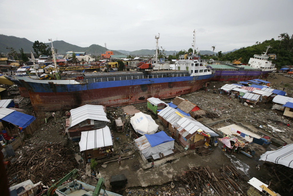 In February, typhoon survivors were still living in temporary shelters they built around cargo ships that were washed inland by Typhoon Haiyan in Tacloban city in central Philippines