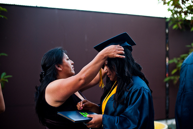 A student graduating from a Green Dot charter high school.
