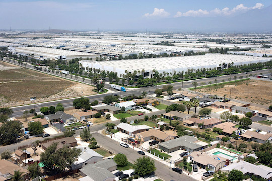 Warehouses stretch out across the Inland Empire, blanketing several cities including Moreno Valley. But some say that expansion has come at a cost.