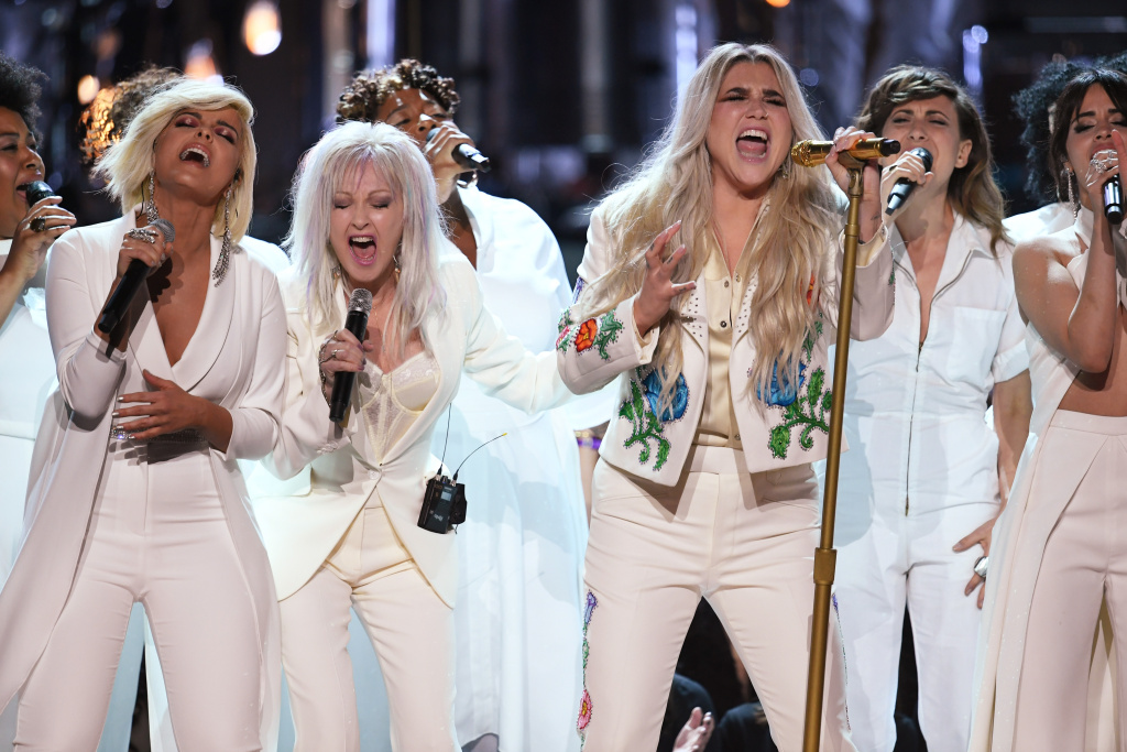 Recording artist Kesha (C) performs with (L-R) Bebe Rexha, Cyndi Lauper and Camila Cabello at the 2018 Grammy Awards.