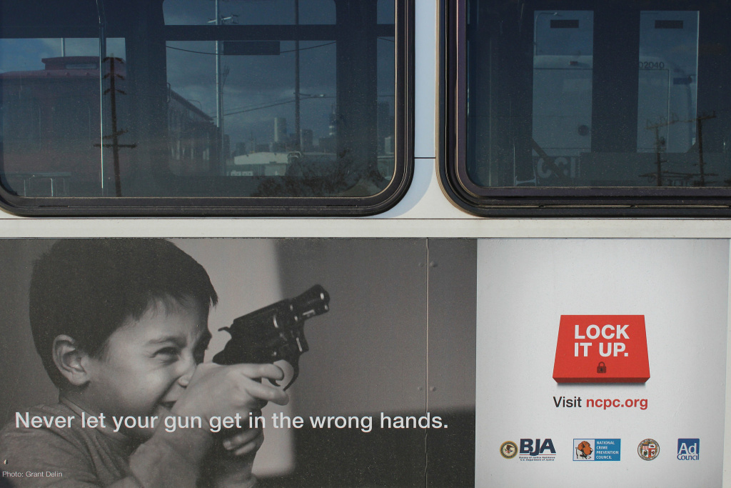 A bus with the Lock It Up gun safety campaign on its side.