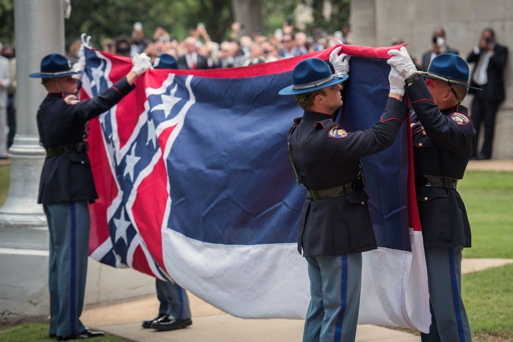 Members of the Mississippi Highway Safety Patrol Honor Guard retire the state flag outside the Mississippi State Capitol building in Jackson, Mississippi on July 1, 2020.