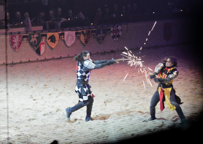 The White & Black Knight vs the Yellow & Red Knight send sparks flying during a battle at a Medieval Times in Schaumburg, IL in 2012.