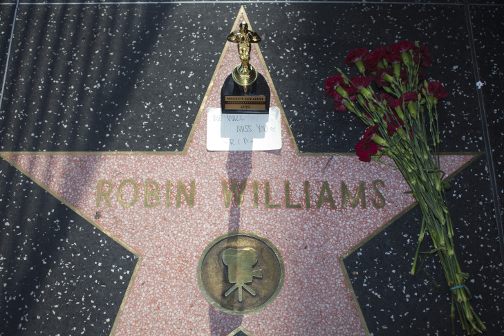 Items are left in memory of Robin Williams on his star along Hollywood Boulevard.
