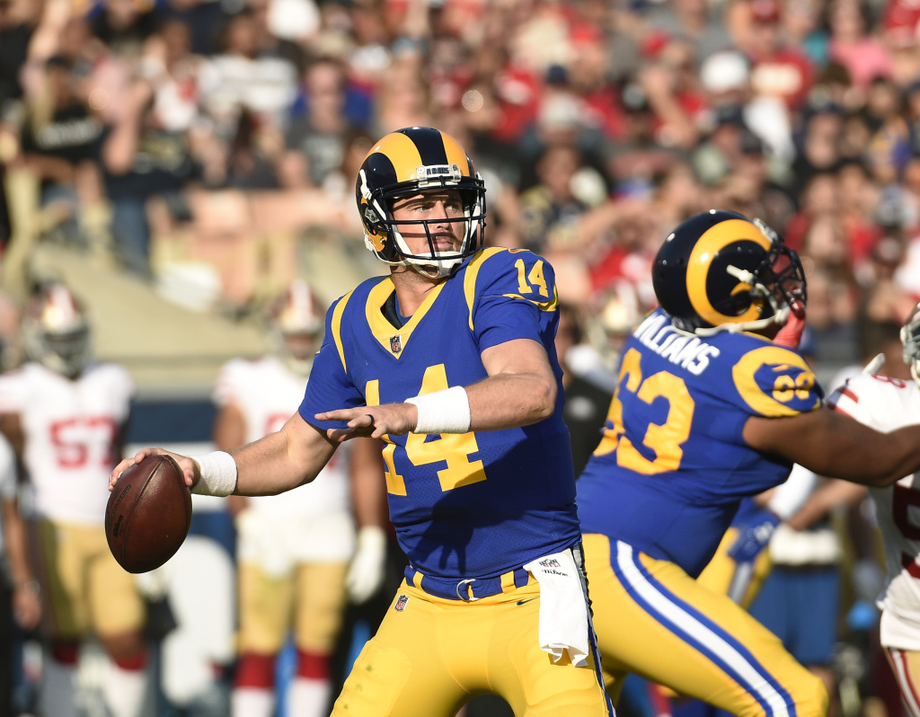 Quarterback Sean Mannion #14 of the Los Angeles Rams throws against San Francisco 49ers during the second quarter at Los Angeles Memorial Coliseum on December 31, 2017 in Los Angeles, California.