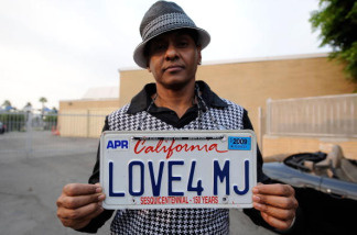 Fan Demarco DeLeon shows of his 'Love4MJ' license plate on the street near Glendale Forest Lawn Memorial Park on September 3, 2009 in Glendale, California.