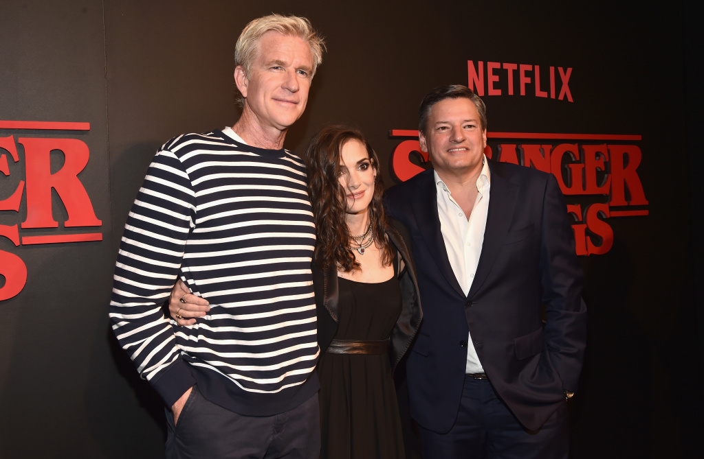 Actor Matthew Modine, actress Winona Ryder and Chief Content Officer for Netflix Ted Sarandos attend the Premiere of Netflix's