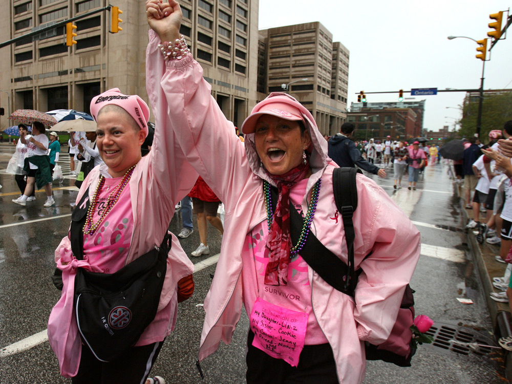 Lindsay Ullman, 31 (left), celebrates with her mother, Dyana Peters, as they cross the finish line after their first 5K walk during the 2008 Susan G. Komen Northeast Ohio Race for the Cure.