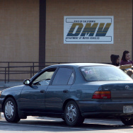 California Department of Motor Vehicles customers sit in the parking lot after finding out that the DMV is closed July 10, 2009 in Corte Madera, California.