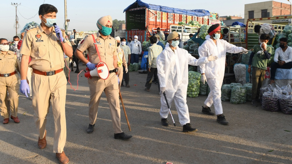 Punjab police patrol at a vegetable wholesale market during a nationwide lockdown against the spread of COVID-19, on the outskirts of Amritsar on May 1.
