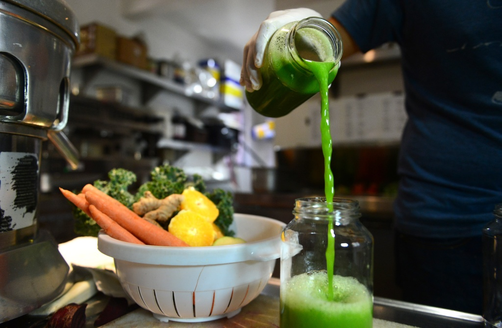 Alexander Mendez displays the juice of the 'Green Giant', which contains cucumber lemon, celery, spinach and kale, at the Silver Lake Juice Bar on September 17, 2013 in the Silver Lake district of Los Angeles, California. In the past two to three years Juice Bars have been growing in popularity and juice cleansing has become a 5 billion dollar industry nationwide, appealing to those who want to lose weight and 'detox' their bodies.
