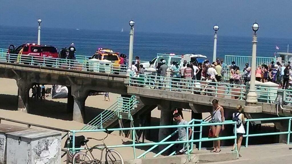 EMTs closed off the Manhattan Beach Pier following a shark attack on Saturday, July 5, 2014.