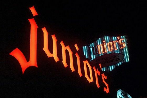 The sign for Junior's Deli in Westwood, Calif. lit up at night.