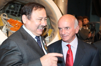 Cosmonaut Talgat Musabayev of Russia (L) and Dennis Tito, the world's first space tourist speaks on April 11, 2011 during a reception devoted to the 50th anniversary of Gagarin's historic first space flight and the upcoming Day of Aviation and Cosmonautics celebrated today in Moscow.