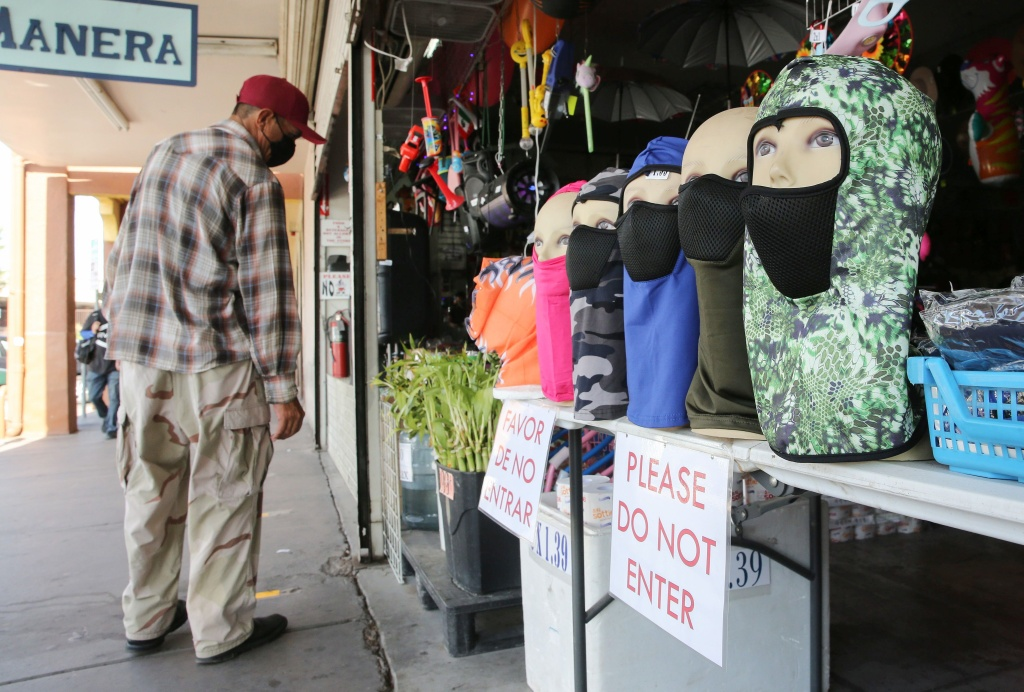 Face masks are displayed at a shop near the U.S.-Mexico border in Imperial County, which has been hard-hit by the COVID-19 pandemic.
