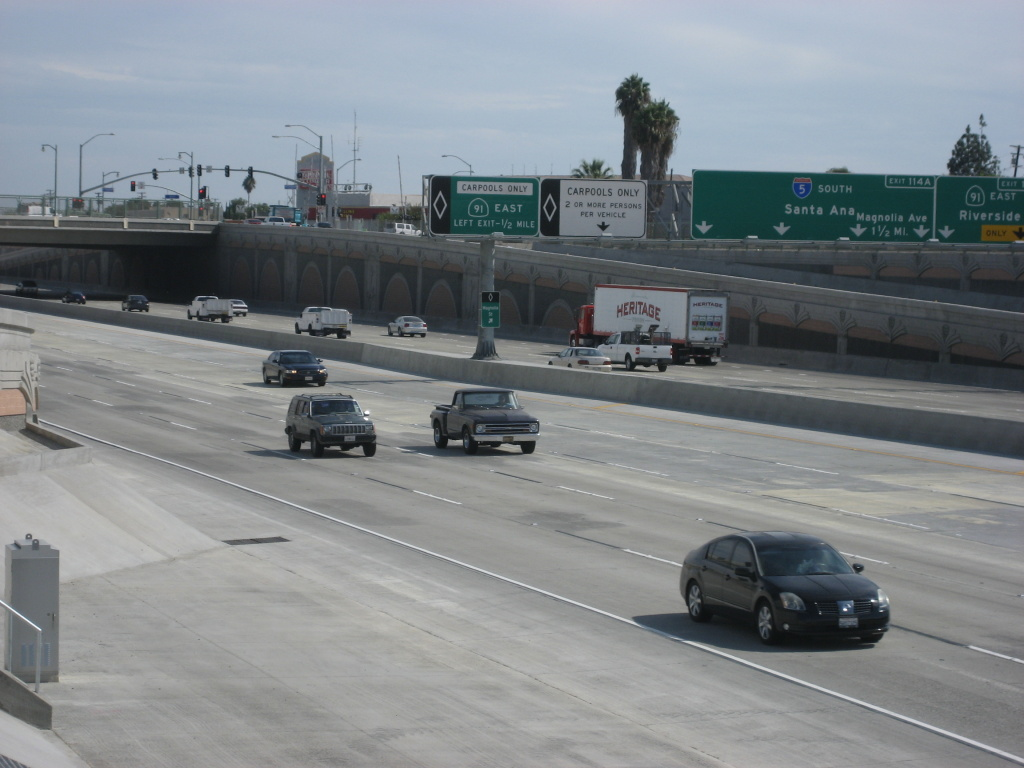 Vehicles travel down the section of Interstate 5 in Orange County that crews recently finished widening.