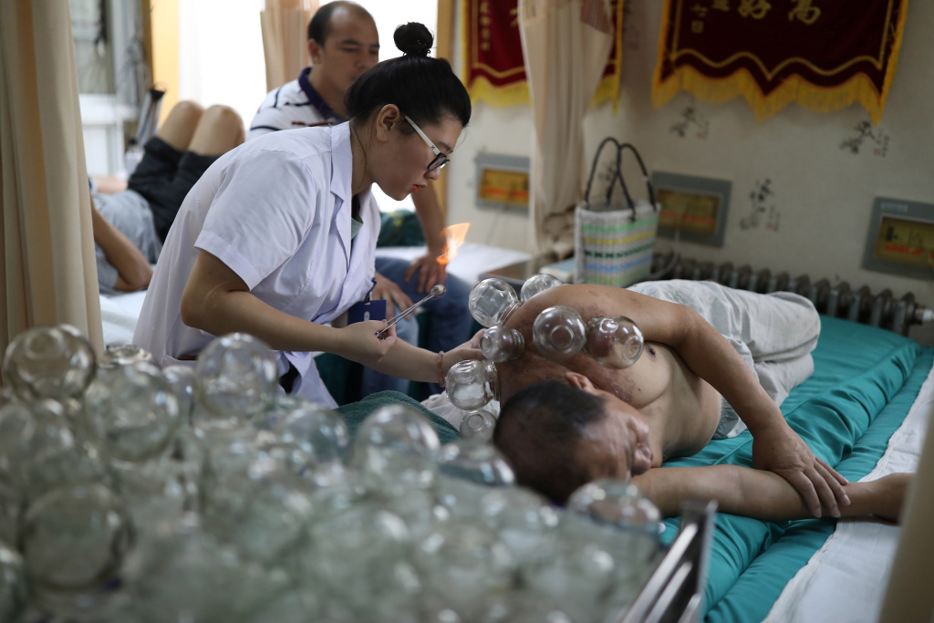 This photo taken on August 7, 2017 shows a patient receiving fire cupping therapy at a hospital in Shenyang in China's northeastern Liaoning province.