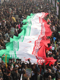 Tens of thousands of Iranians hold up a huge Iranian flag as they march in Azadi Square in southwestern Tehran to mark the 31st anniversary of the Islamic revolution on February 11, 2010.