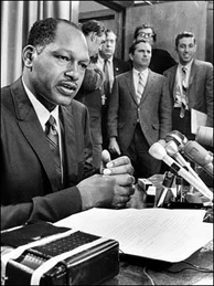 Then-LA City Councilman Tom Bradley (L) at a news conference in 1969. Bob Kholos, Bradley's campaign manager in 1969 and 1973, then mayoral press secretary, is at far right, holding white paper.