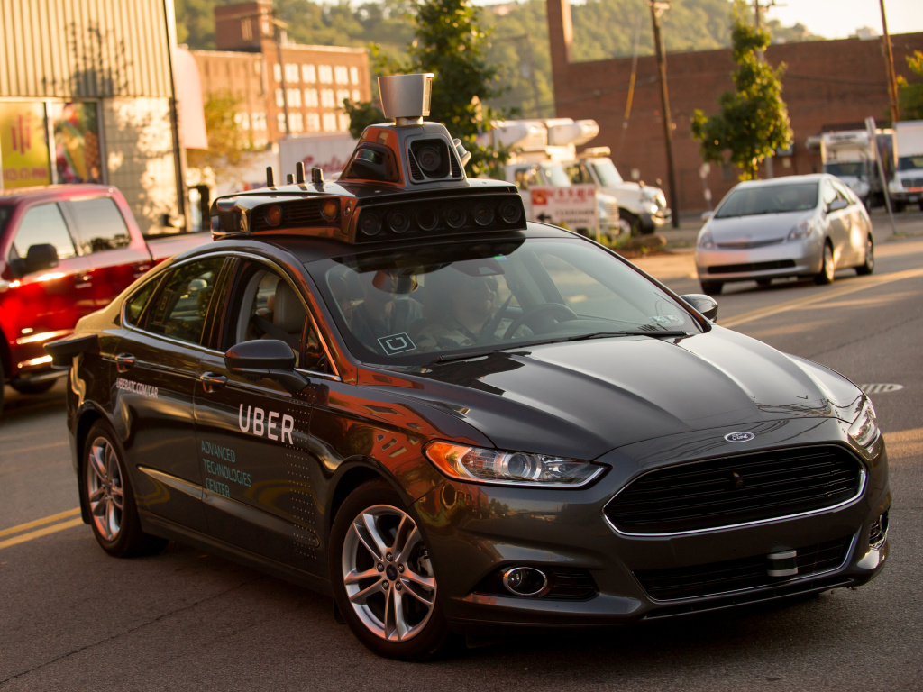 An Uber driverless Ford Fusion drives in Pittsburgh in 2016.