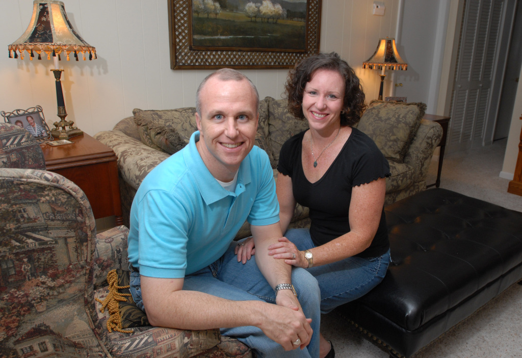 Alan Chambers, left, president of Exodus International, sits with his wife, Leslie, in their home in Winter Park, Fla. The president of the country's best-known Christian ministry dedicated to helping people repress same-sex attraction through prayer is trying to distance the group from the idea that gay people's sexual orientation can be permanently changed or