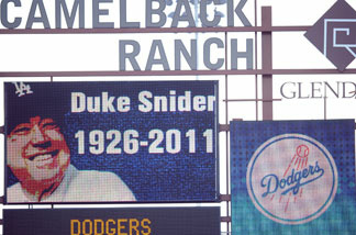 A picture of Duke Snider is displayed on the stadium scoreboard in honor of his life during the game bewteeen the Los Angeles Angels and the Los Angeles Dodgers during spring training at Camelback Ranch on February 27, 2011 in Phoenix, Arizona.