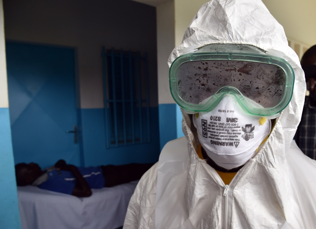 File: A nurse leaves an isolation room after checking a man on August 14, 2014 at the district hospital of Biankouma, during a simulation operation. Public health has a way of slipping off the radar when people aren't scared about Ebola or anthrax. But that doesn't mean the threats go away.