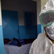 A nurse leaves an isolation room after checking a man on August 14, 2014 at the district hospital of Biankouma, during a simulation operation organized by the Ivory Coast Health Ministry to train medical staff to treat potential patients with Ebola.